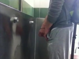 stroking GUY STROKING AT THE URINAL guy